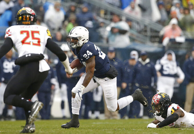 Penn State's Miles Sanders (24) gets past Maryland's Darnell Savage Jr. (4) during the first half of an NCAA college football game in State College, Pa., Saturday, Nov. 24, 2018. (AP Photo/Chris Knight)