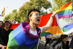 CORRECTS PARTICIPANTS - In this April 15, 2018 photo released by Jiangsu Tongtian Volunteer Group, an LGBT group led more than 100 people in joining a large marathon in the city of Nanjing, hold rainbow flags to raise awareness of LGBT issues. The group had planned to take part in the marathon months in advance. Weibo.com, one of China's top social networking sites announced Monday, April 16, 2018 that it will no longer be censoring content related to gay issues after the plan triggered a loud public outcry. (Jiangsu Tongtian Volunteer Group via AP)