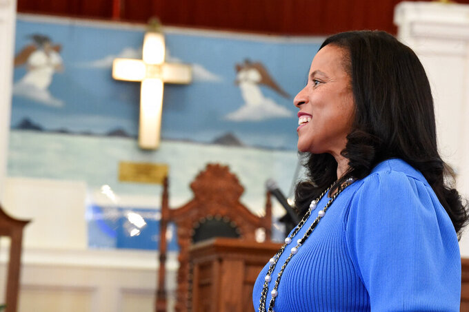 State Sen. Mia McLeod stands in the sanctuary of Shiloh Baptist, her family's church, on Tuesday, June 1, 2021, in Bennettsville, S.C. In her challenge of Gov. Henry McMaster, the Columbia Democrat is the first Black woman to seek South Carolina's top job. (AP Photo/Meg Kinnard)
