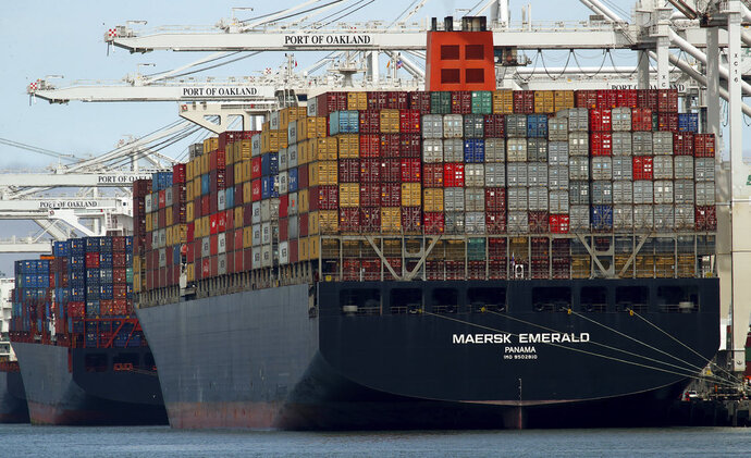 FILE - In this Thursday, July 12, 2018, file photo, the container ship Maersk Emerald is unloaded at the Port of Oakland, Calif. China has announced a 90-day suspension of tariff hikes on $126 billion of U.S. cars, trucks and auto parts following its cease-fire in a trade battle with Washington that threatens global economic growth. (AP Photo/Ben Margot, File)