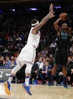 Dallas Mavericks' Harrison Barnes (40) shoots over New York Knicks' Michael Beasley during the first half of an NBA basketball game Tuesday, March 13, 2018, in New York. (AP Photo/Frank Franklin II)