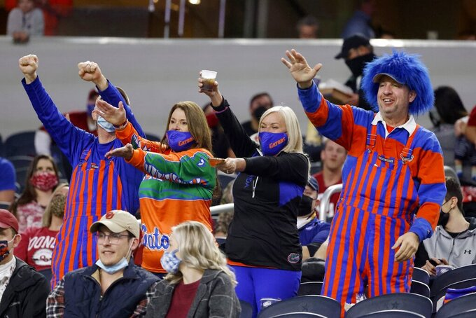 Florida fans cheer on the team during warmups for the Cotton Bowl NCAA college football between Oklahoma and Florida in Arlington, Texas, Wednesday, Dec. 30, 2020. (AP Photo/Michael Ainsworth)