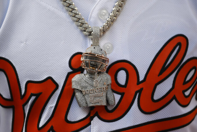 A chain and pendant adorn Baltimore Ravens NFL football draft pick Marquise Brown before a baseball game between the Baltimore Orioles and the Boston Red Sox, Monday, May 6, 2019, in Baltimore. Brown and fellow draft pick Jaylon Ferguson threw out ceremonial first pitches before the game. (AP Photo/Nick Wass)
