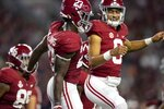 Alabama running back Roydell Williams (23) and quarterback Bryce Young (9) celebrate William's touchdown run against Southern Mississippi during the first half of an NCAA college football game, Saturday, Sept. 25, 2021, in Tuscaloosa, Ala. (AP Photo/Vasha Hunt)