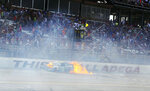 FILE - In this April 30, 2016, file photo, flames come from Blake Koch's car after a wreck just before the finish of the NASCAR Xfinity Series auto race at Talladega Superspeedway, in Talladega, Ala. The ever-present air of unpredictability at Talladega Superspeedway is even more pronounced than usual this weekend, with NASCAR having replaced the horsepower-sapping restrictor plates.(AP Photo/Jay Alley, File)
