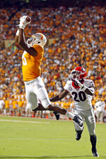 Tennessee wide receiver Jauan Jennings (15) catches a pass for a touchdown in front of Georgia defensive back J.R. Reed (20) in the first half of an NCAA college football game, Saturday, Oct. 5, 2019, in Knoxville, Tenn. (AP Photo/Wade Payne)