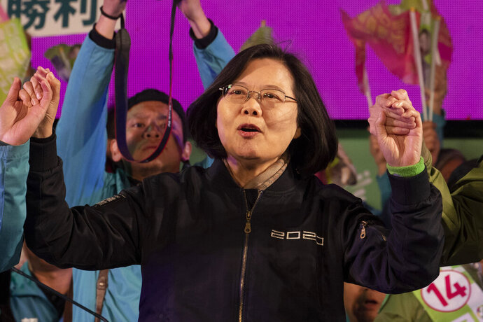 In this Jan. 8, 2020, photo, Tsai Ing-wen, Taiwan's President and the 2020 presidential election candidate for the Democratic Progressive Party (DPP), chants slogans during an election campaign rally in northern Taiwan's Hsinchu province. A year ago, the Taiwan leader was on the ropes. Now President Tsai appears poised to win a second four-year term in elections this Saturday. (AP Photo/Ng Han Guan)