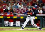 Washington Nationals' Keibert Ruiz hits an RBI-single against Cincinnati Reds pitcher Sonny Gray during the third inning of a baseball game in Cincinnati, Ohio, Friday, Sept. 24, 2021. (AP Photo/Paul Vernon)