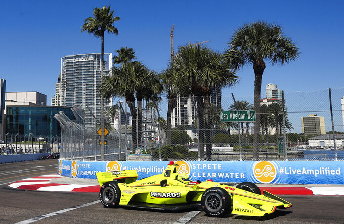 FILE - In this March 9, 2018, file photo, the City of St. Petersburg is pictured in the background as IndyCar driver Simon Pagenaud makes his way through turn 10 during the first IndyCar practice on the first day of the Firestone Grand Prix of St. Petersburg, Fla. The IndyCar season opens Sunday, March 10, 2019, in St. Petersburg. (Dirk Shadd/The Tampa Bay Times via AP, File)