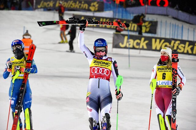 Petra Vlhova of Slovakia, center, flanked by second placed Mikaela Shiffrin of the United States, left, and third placed Katharina Liensberger of Austria, celebrates after winning the alpine ski, women's World Cup slalom in Levi, Finland, Saturday, Nov. 21, 2020. (Jussi Nukari/Lehtikuva via AP)