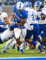 Air Force running back Kadin Remsberg (24) runs into the end zone past San Jose State safety Tre Webb (3) for a touchdown during the first quarter of an NCAA college football game, Friday, Sept. 27, 2019, at Air Force Academy, Colo. (Christian Murdock/The Gazette via AP)