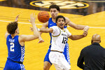 Missouri's Dru Smith, right, is fouled by Kentucky's Lance Ware, back, as he loses the ball in front of Devin Askew, left, during the second half of an NCAA college basketball game Wednesday, Feb. 3, 2021, in Columbia, Mo. Missouri won 75-70. (AP Photo/L.G. Patterson)