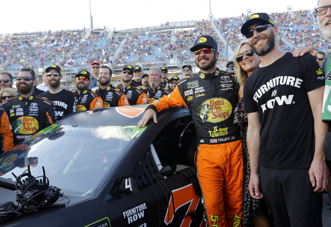 Martin Truex Jr. poses with his crew before the NASCAR Series Championship auto race at the Homestead-Miami Speedway, Sunday, Nov. 18, 2018, in Homestead, Fla. (AP Photo/Lynne Sladky)