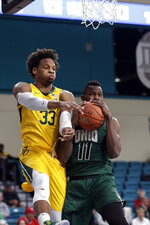 Baylor forward Freddie Gillespie (33) and Ohio forward Sylvester Ogbonda (11) reach for a rebound during the first half of an NCAA college basketball game at the Myrtle Beach Invitational in Conway, S.C., Thursday, Nov. 21, 2019. (AP Photo/Gerry Broome)