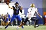 Memphis quarterback Brady White throws the ball past Navy's Jacob Springer during an NCAA college football game Thursday, Sept. 26, 2019, in Memphis Tenn. (Joe Rondone/The Commercial Appeal via AP)