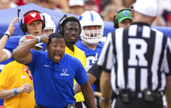 Buffalo head coach Maurice Linguist argues with a referee following a play against Nebraska during the second half of an NCAA college football game Saturday, Sept. 11, 2021, at Memorial Stadium in Lincoln, Neb. An unsportsmanlike conduct penalty was called on the Buffalo bench following the exchange. (AP Photo/Rebecca S. Gratz)