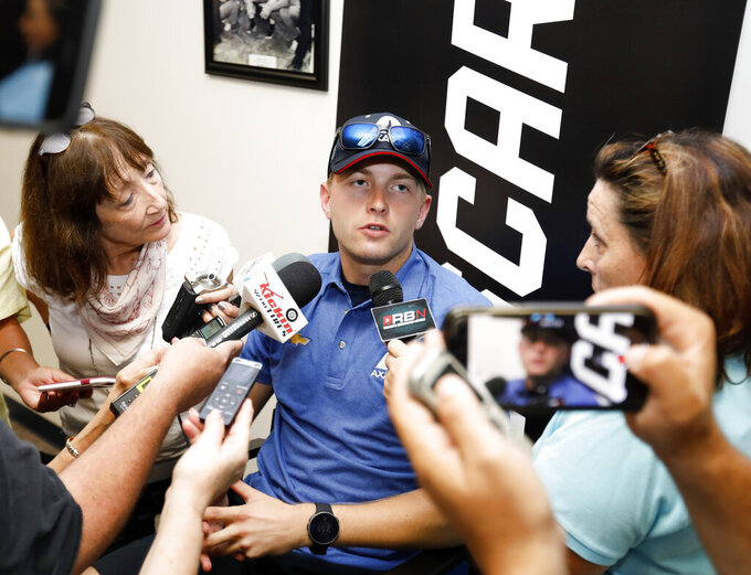 William Byron answers questions during a NASCAR auto race news conference at Daytona International Speedway, Friday, July 5, 2019, in Daytona Beach, Fla. (AP Photo/Terry Renna)
