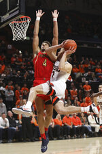Arizona's Chase Jeter (4) tries to block a shot by Oregon State's Tres Tinkle (3) during the first half of an NCAA college basketball game in Corvallis, Ore., Thursday, Feb. 28, 2019. (AP Photo/Amanda Loman)