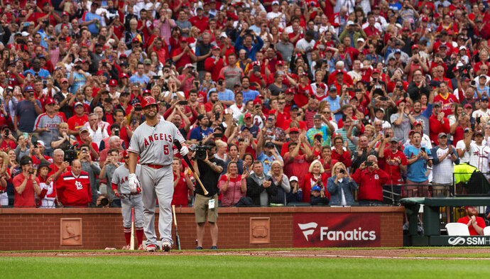 Los Angeles Angels' Albert Pujols (5) is greeted by a standing ovation before his first at-bat during the first inning a baseball game against the St. Louis Cardinals, Friday, June 21, 2019, in St. Louis. (AP Photo/L.G. Patterson)