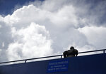 Storm clouds build over a cadet on a bridge over the tunnel leading to the lockerrooms at Falcom Stadium after an NCAA college football game Saturday, Sept. 1, 2018, at Air Force Academy, Colo. Air Force won 38-0 over Stony Brook. The game was delayed twice because of threatening weather. (AP Photo/David Zalubowski)