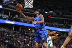 Denver Nuggets guard Will Barton, front, shoots next to Boston Celtics center Robert Williams III during the first half of an NBA basketball game Friday, Nov. 22, 2019, in Denver. (AP Photo/David Zalubowski)