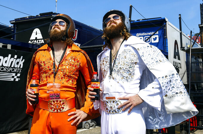 Jasen Speerbreacker and Josh Speerbreacker walk through the garage before the Geico 500 at Talladega Superspeedway, Sunday, April 28, 2019, in Talladega, Ala. (AP Photo/Butch Dill)