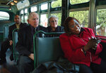 FILE - In this December 2005 file photo, Rev. Robert Graetz, second from left, and wife, Jeannie, sing along with Gladys Williams, right, on the Cleveland Avenue bus, during the walk of remembrance to commemorate the 50th anniversary of the Montgomery Bus Boycott in Montgomery, Ala. Graetz, the only white minister to support the Montgomery bus boycott, died Sunday, Sept. 20, 2020. He was 92. (Karen S. Doerr/The Montgomery Advertiser via AP, File)