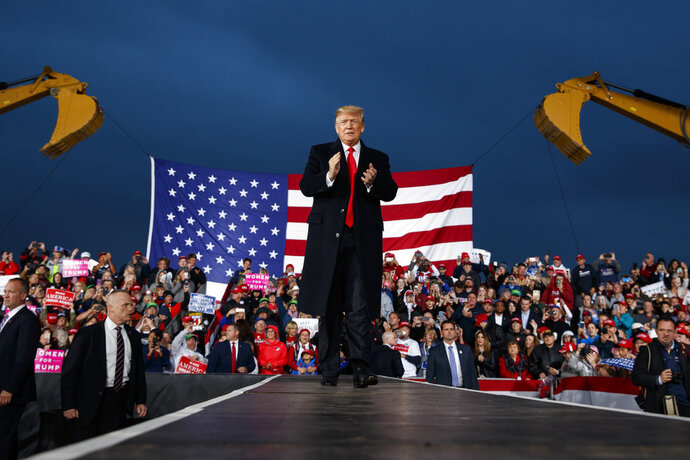 President Donald Trump waves as he arrives for a campaign rally, Friday, Oct. 12, 2018, in Lebanon, Ohio. (AP Photo/Evan Vucci)