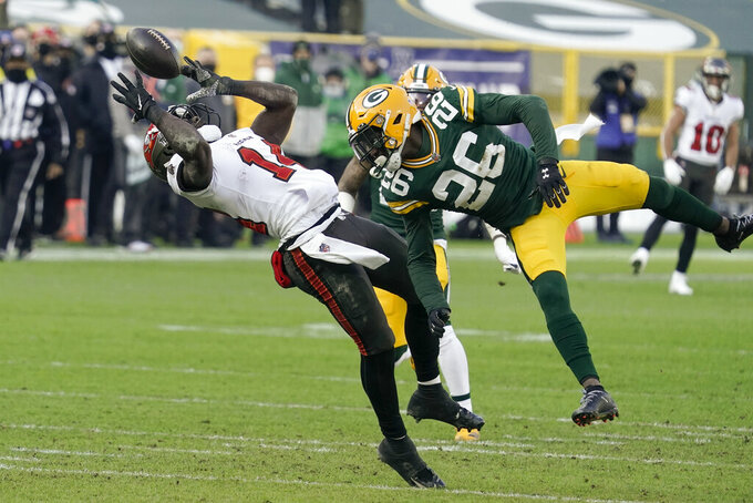 Tampa Bay Buccaneers' Chris Godwin (14) catches a pass against Green Bay Packers' Darnell Savage (26) during the first half of the NFC championship NFL football game in Green Bay, Wis., Sunday, Jan. 24, 2021. (AP Photo/Morry Gash)