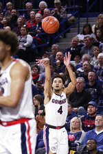 Gonzaga guard Ryan Woolridge (4) shoots during the first half of the team's NCAA college basketball game against Arkansas-Pine Bluff in Spokane, Wash., Saturday, Nov. 9, 2019. (AP Photo/Young Kwak)