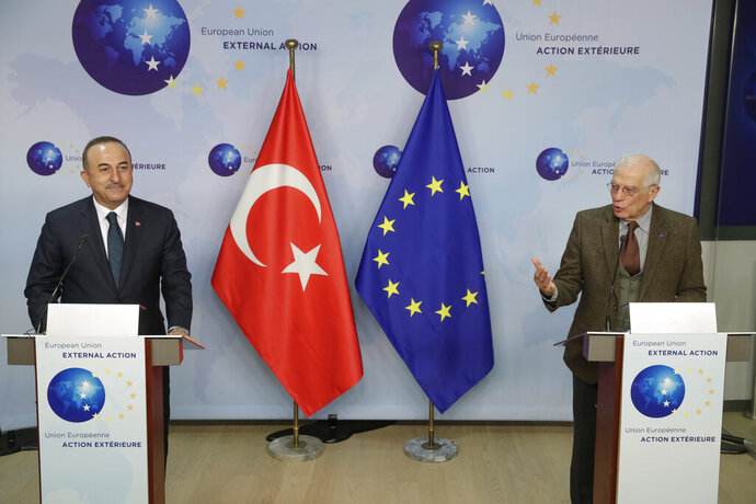 Turkey's Foreign Minister Mevlut Cavusoglu, left, and European Union foreign policy chief Josep Borrell give a joint statement prior to their meeting in Brussels, Thursday, Jan. 21, 2021. (Stephanie Lecocq/Pool Photo via AP)