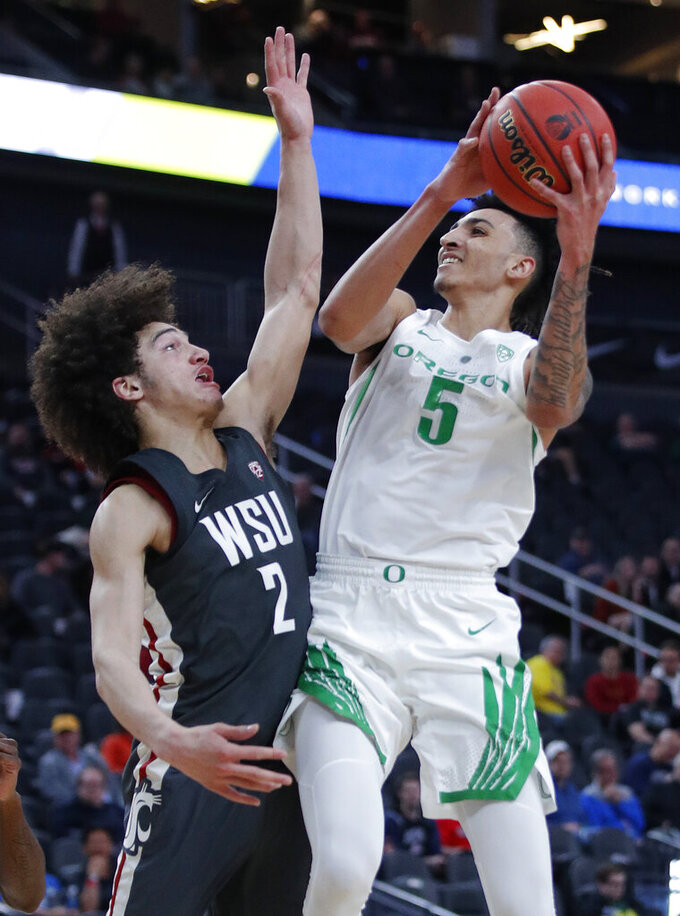 Oregon's Miles Norris shoots over Washington State's CJ Elleby during the second half of an NCAA college basketball game in the first round of the Pac-12 men's tournament Wednesday, March 13, 2019, in Las Vegas. (AP Photo/John Locher)