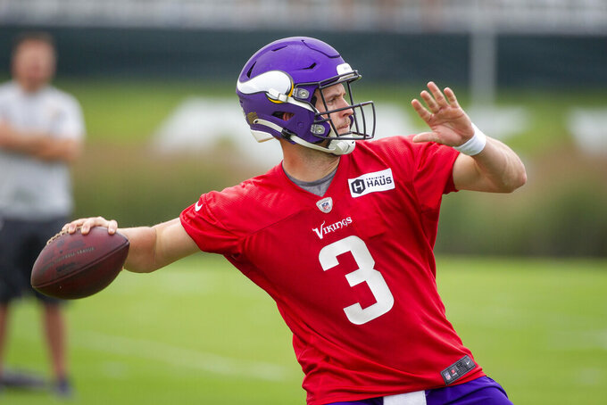 FILE - In this Wednesday, July 28, 2021 file photo, Minnesota Vikings quarterback Jake Browning (3) participates in NFL training camp in Eagan, Minn. Jake Browning bided his time on Minnesota's practice squad the last two years, and his opportunity to prove his worth as the primary backup quarterback for the Vikings came suddenly this weekend when Kirk Cousins and the other two backups were sidelined under COVID-19 protocols.(AP Photo/Bruce Kluckhohn, File)
