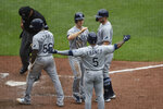 Tampa Bay Rays' Joey Wendle, top center, is congratulated by Wander Franco (5), Austin Meadows, top right, and Randy Arozarena, bottom left, after hitting a grand slam against the Baltimore Orioles in the seventh inning of baseball game, Sunday, Aug. 29, 2021, in Baltimore. (AP Photo/Gail Burton)