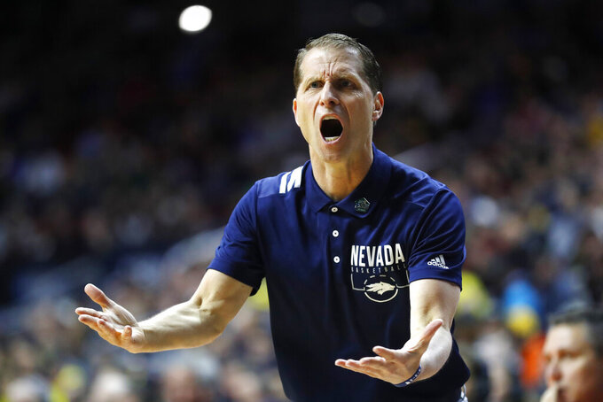 Nevada head coach Eric Musselman questions a call against his team during a first round men's college basketball game against Florida in the NCAA Tournament, Thursday, March 21, 2019, in Des Moines, Iowa. (AP Photo/Charlie Neibergall)
