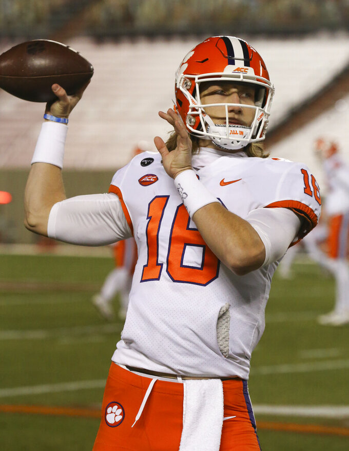 Clemson quarterbackTrevor Lawrence warms up before an NCAA college football game against Virginia Tech in Blacksburg, Va., Saturday, Dec. 5, 2020. (Matt Gentry/The Roanoke Times via AP, Pool)