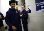 Murray State's head coach Matt McMahon, right, smiles as Ja Morant heads to the locker room after a news conference at the men's college basketball NCAA Tournament, Friday, March 22, 2019, in Hartford, Conn. Murray State will play Florida State on Saturday. (AP Photo/Elise Amendola)