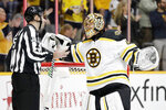 Boston Bruins goaltender Tuukka Rask, of Finland, argues with linesman Andrew Smith, left, after the Nashville Predators scored a goal in the second period of an NHL hockey game Tuesday, Jan. 7, 2020, in Nashville, Tenn. The goal was disallowed after it was ruled the net came loose during the goal. (AP Photo/Mark Humphrey)
