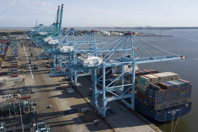 FILE - In this Friday, May 10, 2019 file photo, a container ship is unloaded at the Virginia International Gateway terminal in Norfolk, Va. U.S. factories expanded unexpectedly in January 2020, snapping a five-month losing streak. The Institute for Supply Management, an association of purchasing managers, said Monday, Feb. 3, 2020, that its manufacturing index rose to 50.9 in January, from 47.8 in December. Anything above 50 signals expansion. (AP Photo/Steve Helber, File)
