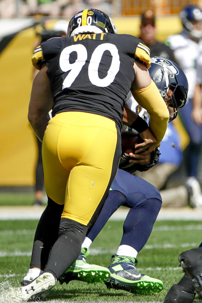Pittsburgh Steelers outside linebacker T.J. Watt (90) sacks Seattle Seahawks quarterback Russell Wilson (3) in the first half of an NFL football game, Sunday, Sept. 15, 2019, in Pittsburgh. (AP Photo/Gene J. Puskar)