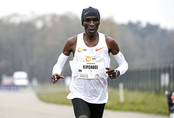 FILE - In this April 18, 2021, file photo, Eliud Kipchoge of Kenya runs to win the NN Mission Marathon at Enschede Airport in Enschede, Netherlands. The Olympic marathons, along with the race walks, were shifted a four-hour train ride north to Sapporo because of the extreme heat in Tokyo. Kipchoge is the defending champion. (Piroschka van de Wouw/Pool Photo via AP, File)