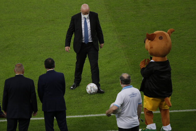 FIFA president Gianni Infantino plays with a ball prior to the Copa America final soccer match between Brazil and Argentina at the Maracana stadium in Rio de Janeiro, Brazil, Saturday, July 10, 2021. (AP Photo/Silvia Izquierdo)