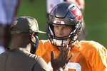 Tampa Bay Buccaneers quarterback Tom Brady talks to offensive coordinator Byron Leftwich during an NFL football training camp practice Friday, Aug. 28, 2020, in Tampa, Fla. (AP Photo/Chris O'Meara)