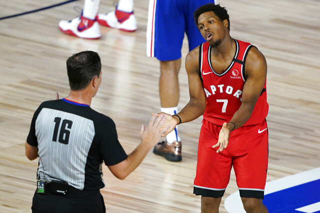 Toronto Raptors' Kyle Lowry (7) reacts after referee David Guthrie (16) called him for a technical foul during the first half of an NBA basketball game against the Philadelphia 76ers Wednesday, Aug. 12, 2020 in Lake Buena Vista, Fla. (AP Photo/Ashley Landis, Pool)