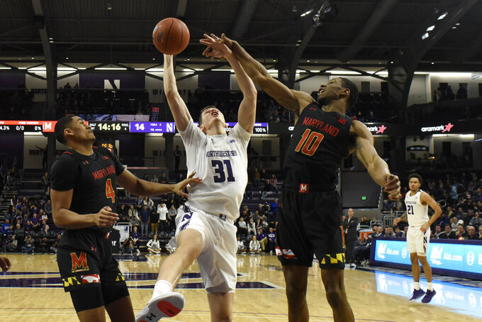 Maryland forward Ricky Lindo Jr. (4) and guard Serrel Smith Jr. (10) defend Northwestern forward Robbie Beran (31) during the first half of an NCAA college basketball game, Tuesday, Jan. 21, 2020, in Evanston, Ill. (AP Photo/David Banks)