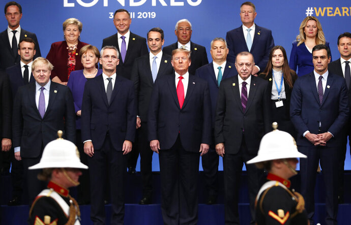 FILE - In this Dec. 4, 2019, file photo, from front row left, British Prime Minister Boris Johnson, NATO Secretary General Jens Stoltenberg, U.S. President Donald Trump, Turkish President Recep Tayyip Erdogan and Spanish Prime Minister Pedro Sanchez attend a ceremony event during a NATO leaders meeting at The Grove hotel and resort in Watford, Hertfordshire, England. People have taken to the streets around the world to demonstrate in support of Black Lives Matter protesters in the United States and to vent anger over Trump's response to the police killing of George Floyd. But leaders of traditional allies of the United States have taken pains to avoid criticizing Trump directly. (AP Photo/Francisco Seco, File)