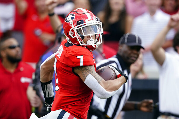 Georgia wide receiver Jermaine Burton (7) looks over his shoulder as he runs for a touchdown after a catch during the first half of an NCAA college football game against UAB, Saturday, Sept. 11, 2021, in Athens, Ga. (AP Photo/John Bazemore)