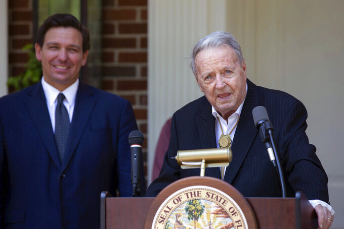 Former Florida State University NCAA college football coach Bobby Bowden speaks before being presented with the Governor's Medal of Freedom from Gov. Ron DeSantis, left, at the Governor's Mansion in Tallahassee, Fla., Wednesday, April 7, 2021. (Tori Lynn Schneider/Tallahassee Democrat via AP)