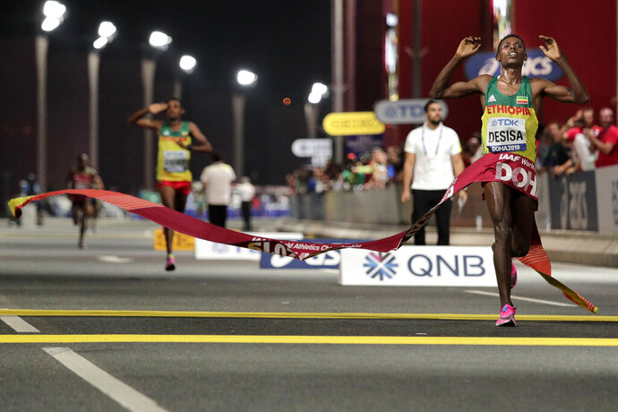 Lelisa Desisa, of Ethiopia, wins the men's marathon at the World Athletics Championships in Doha, Qatar, Sunday, Oct. 6, 2019. (AP Photo/Nariman El-Mofty)