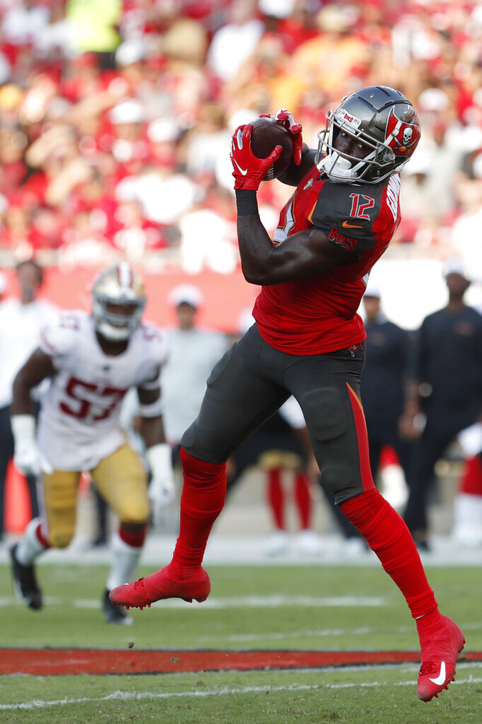 Tampa Bay Buccaneers wide receiver Chris Godwin (12) makes a catch against San Francisco 49ers during the second half an NFL football game, Sunday, Sept. 8, 2019, in Tampa, Fla. (AP Photo/Mark LoMoglio)